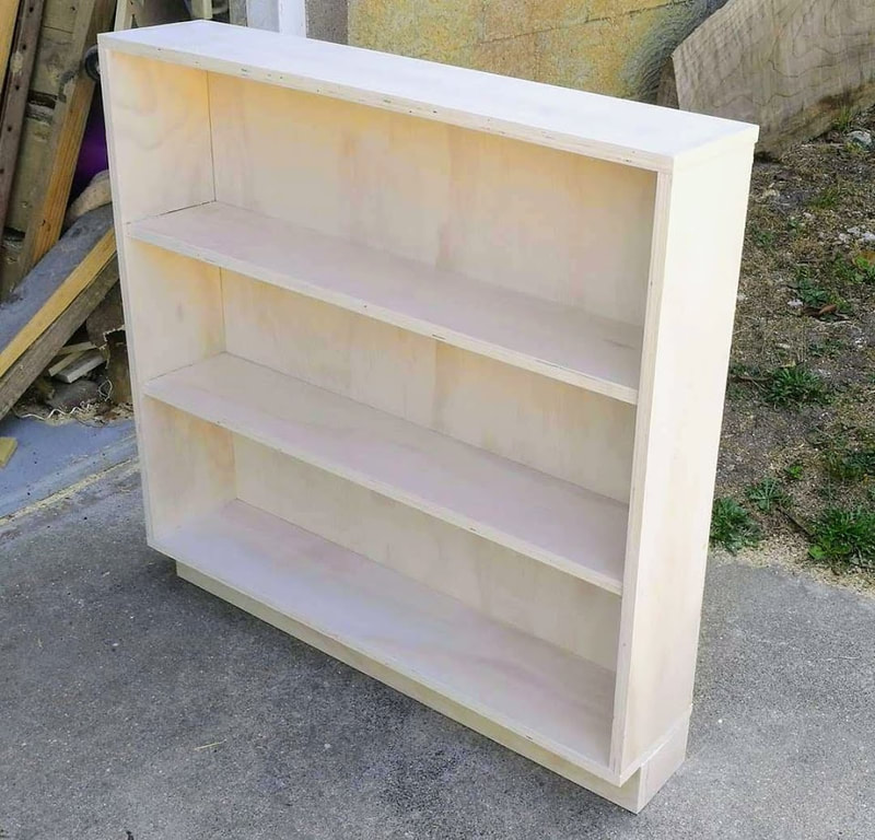 whitewashed small bookcase